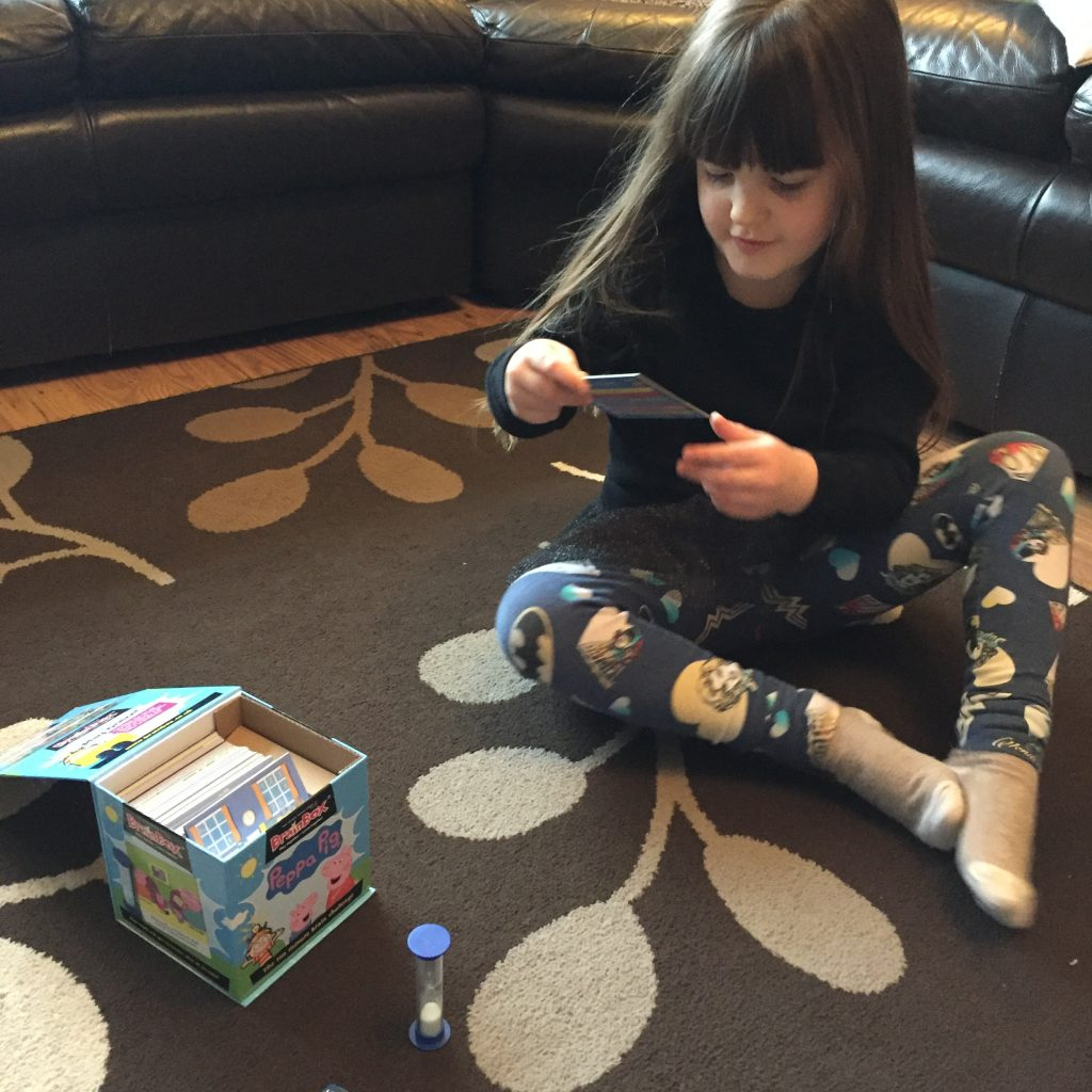 child playing Peppa Pig game reading cards