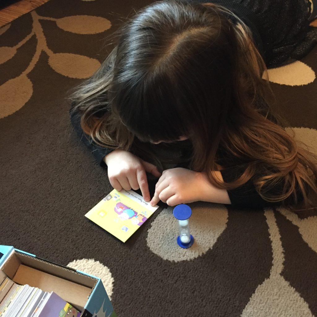 child reading Peppa Pig game