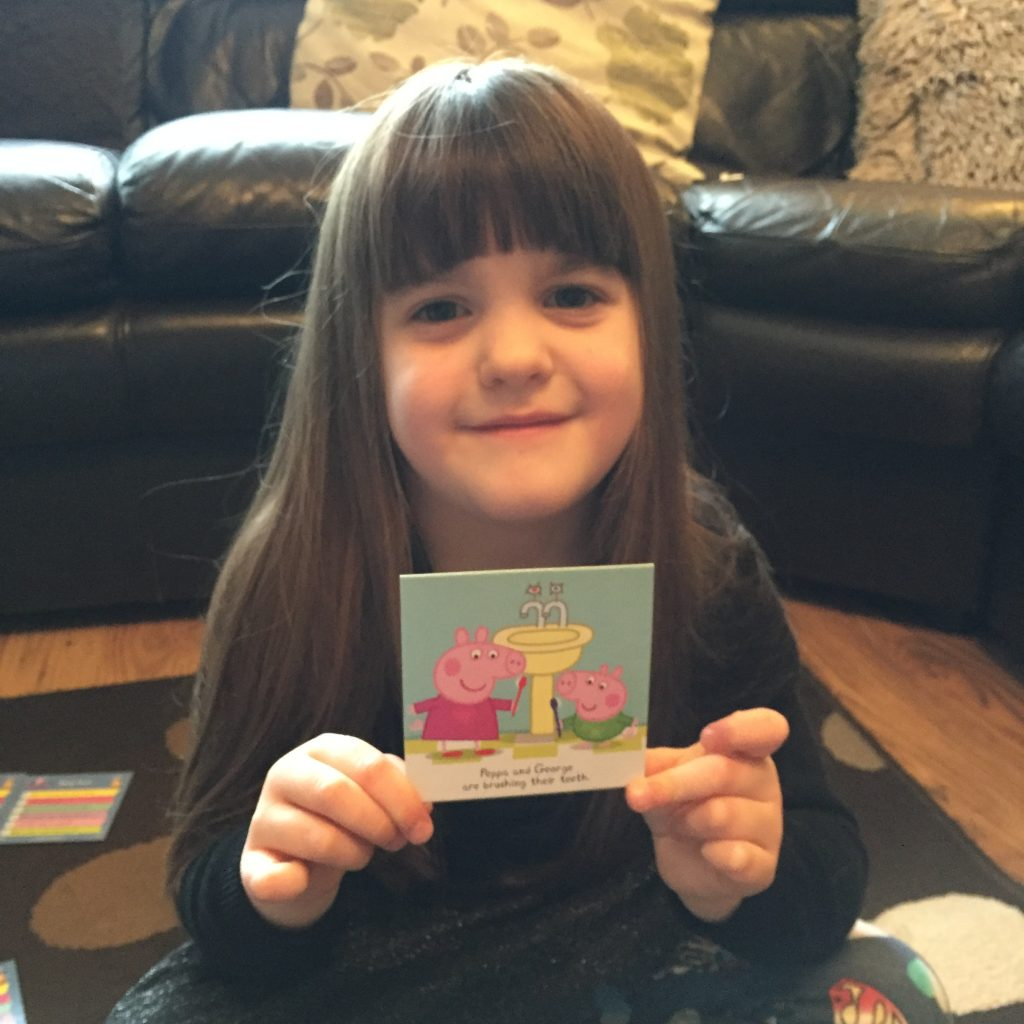 child with Peppa Pig card from game
