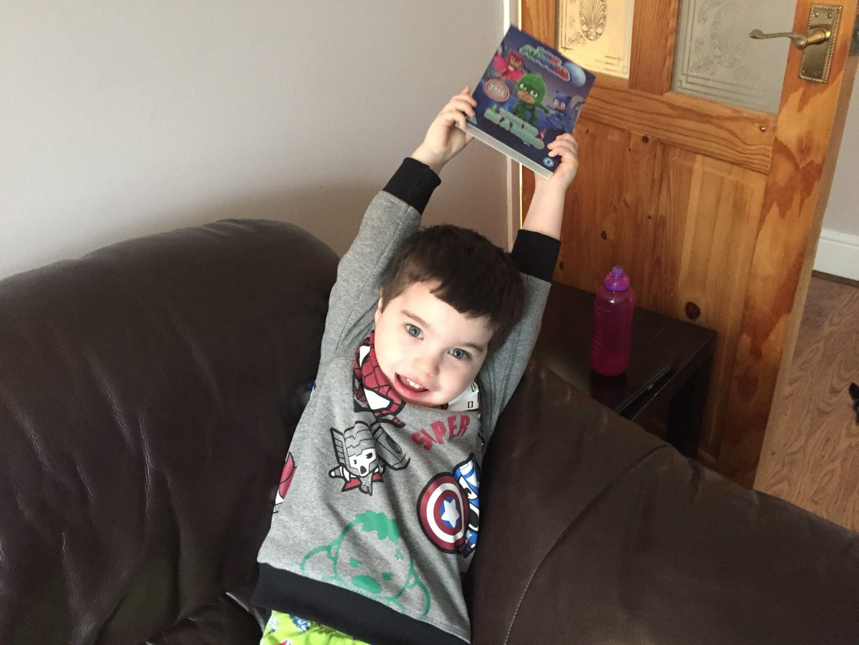 boy brandishing pj masks time to be a hero dvd