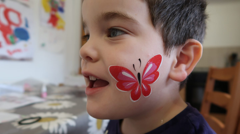 boy wearing fablab temporary face tattoo on cheek