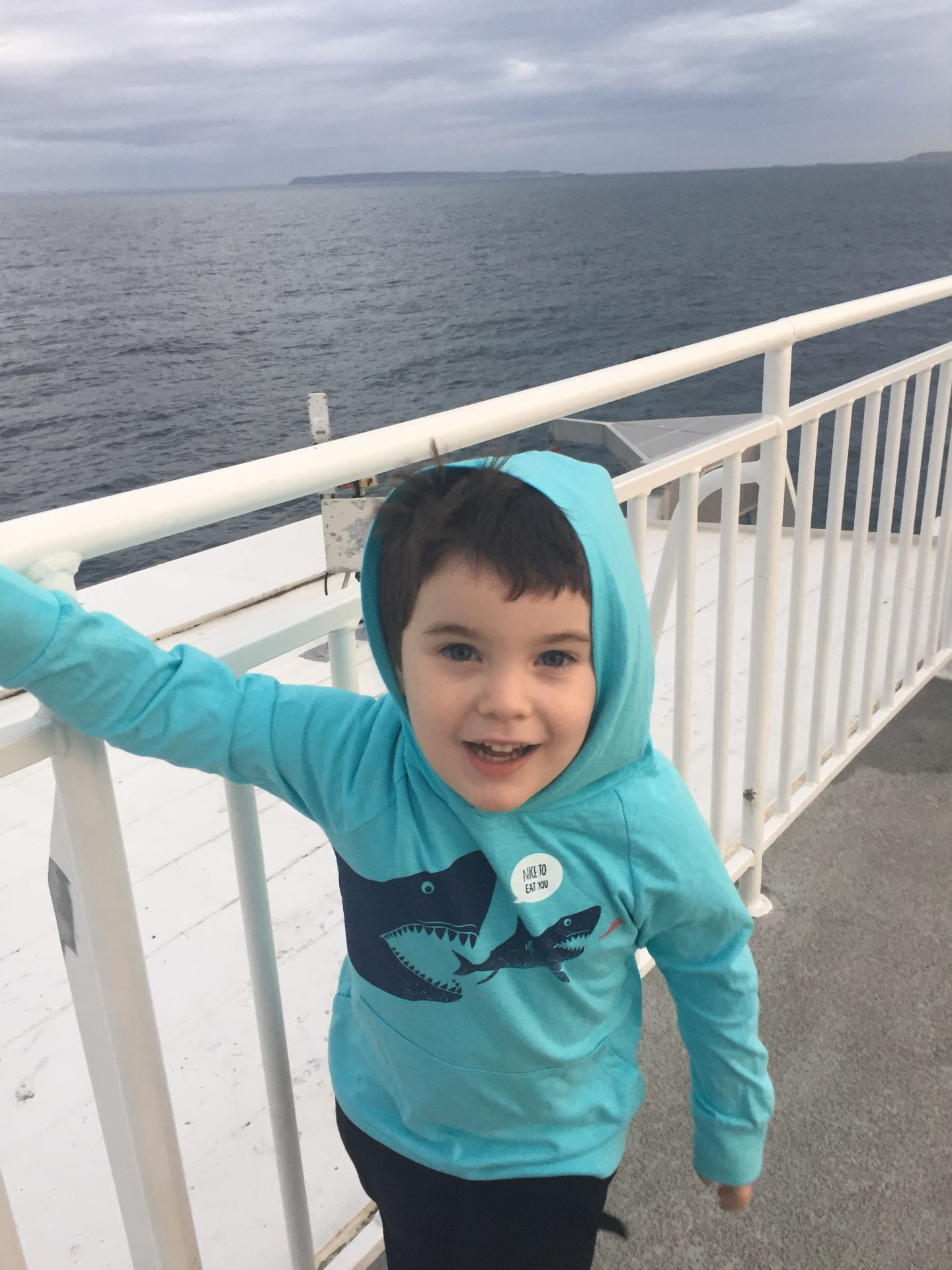 boy smiling on observation deck The Condor Liberation condor ferries