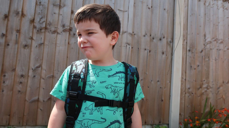boy wearing smiggle backpack