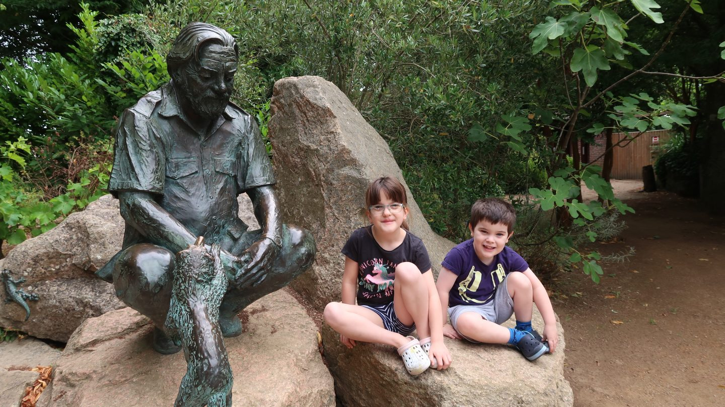 children sitting with gerald durrell at jersey zoo