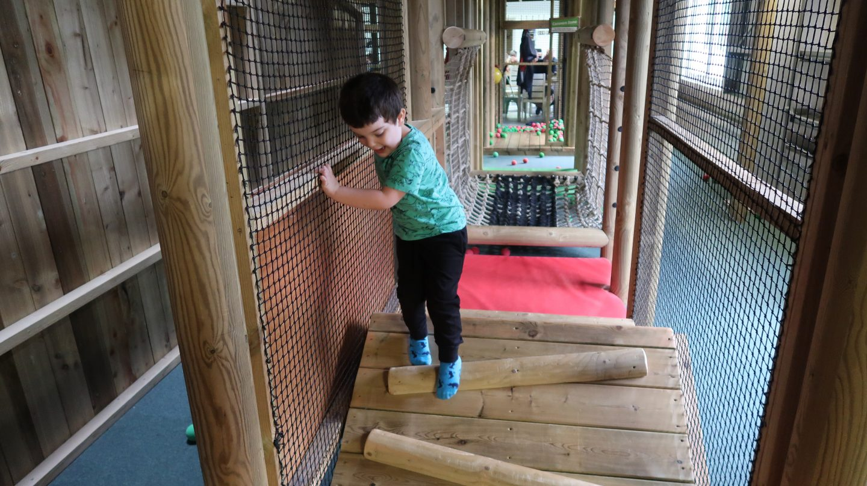 boy climbing through aMaizin! adventure park jersey