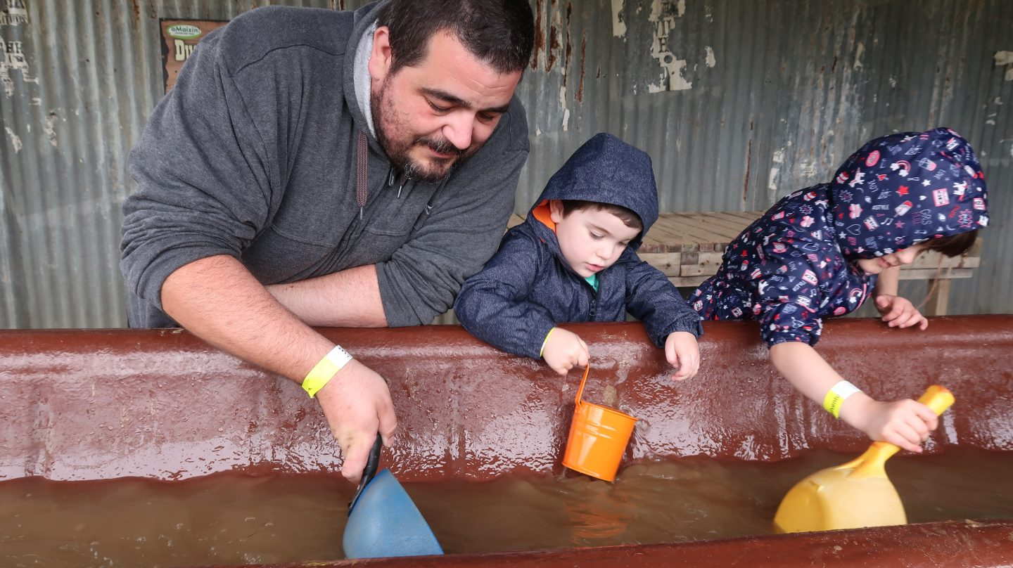 father and children panning for gold aMaizin! adventure park jersey
