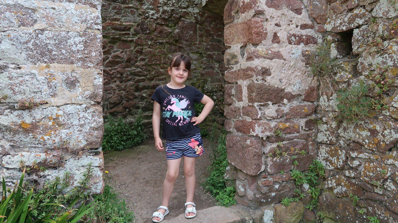 girl striking a pose at Mont Orgueil Castle Jersey