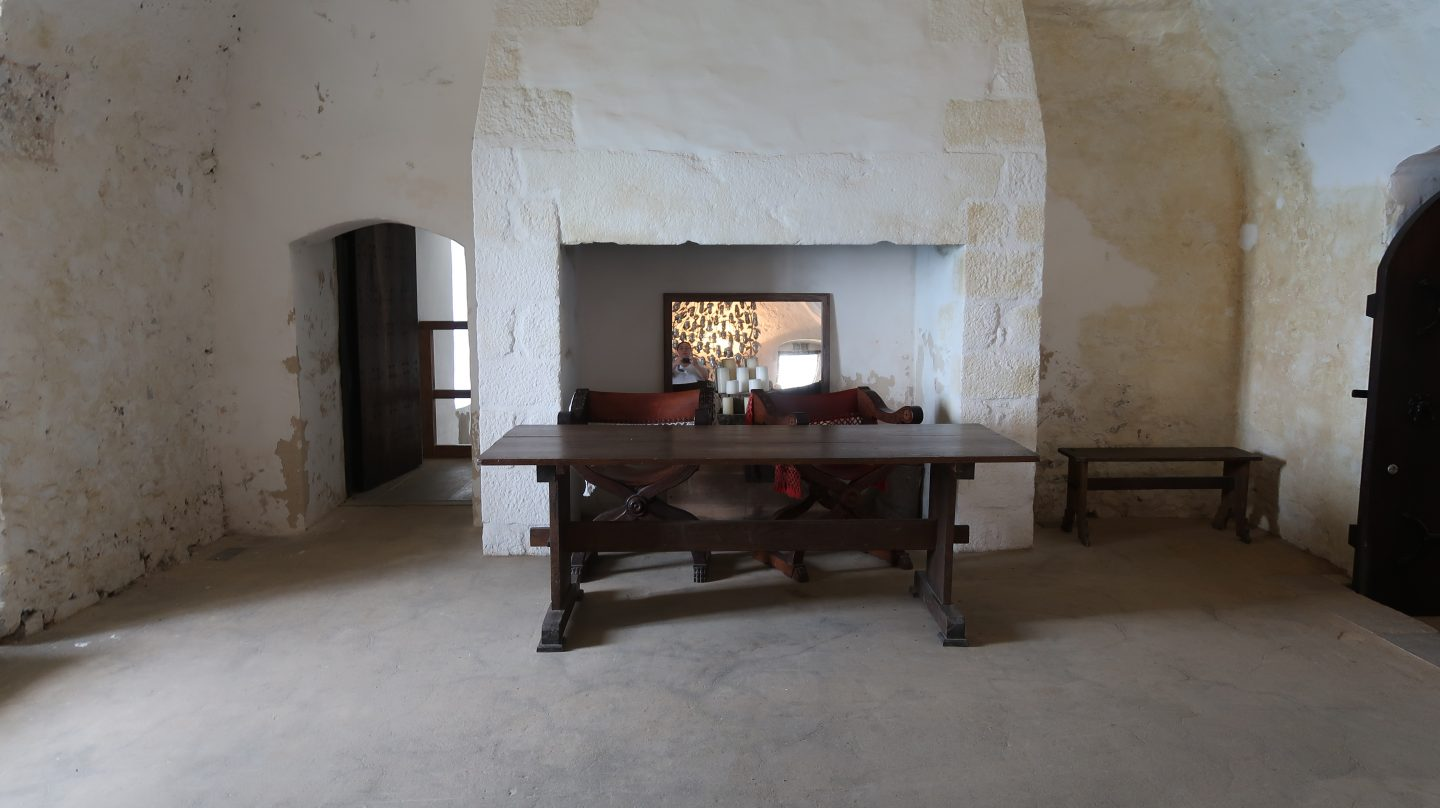 restored table and chairs Mont Orgueil Castle Jersey
