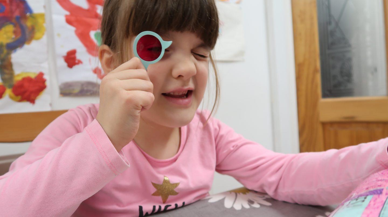 child with spyglass
