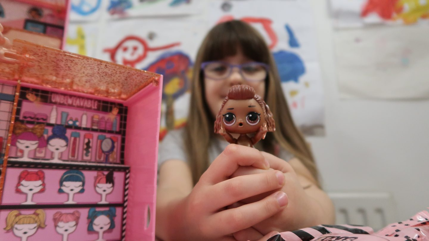 girl with lol doll