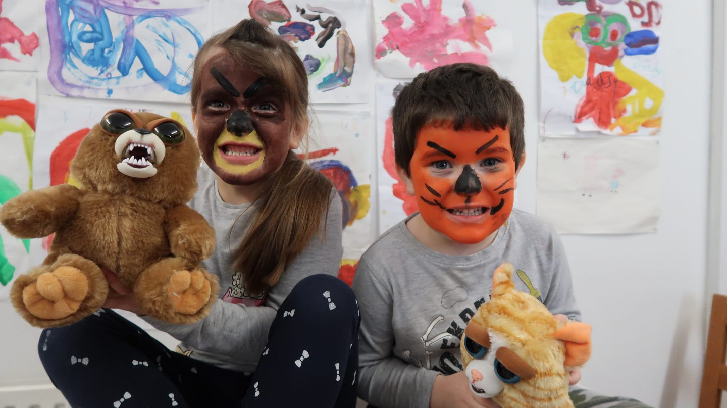 kids with face painted like feisty pet toys