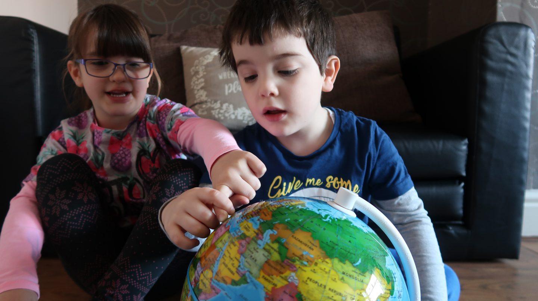 kids looking at smart globe