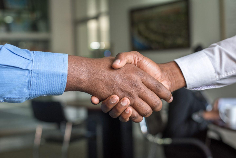 close up of a handshake between two men