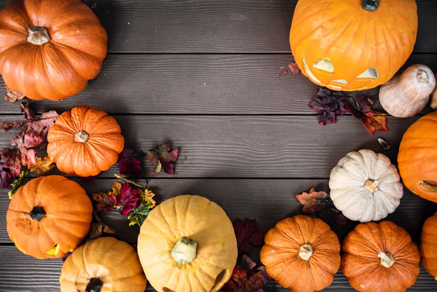 pumkins on wooden porch from above