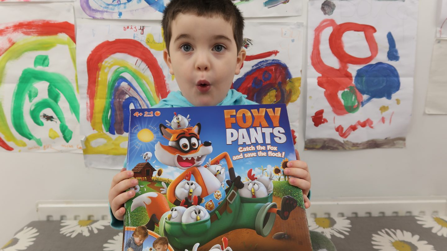 excited boy holding foxy pants game