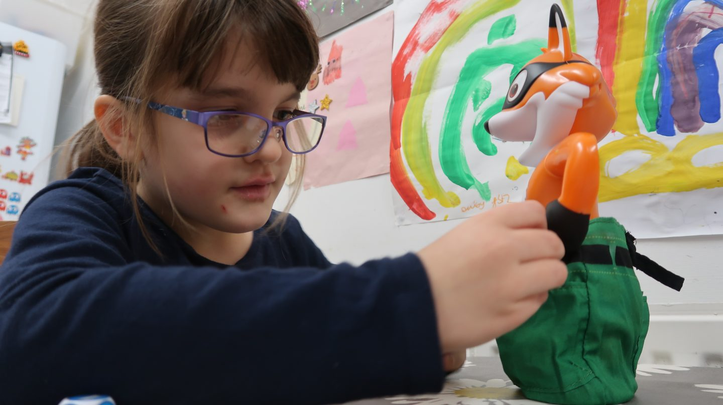 girl in glasses playing foxy pants
