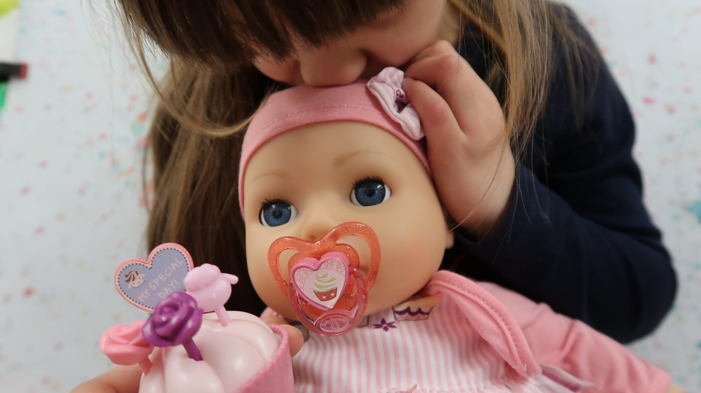 girl kissing baby annabell my special day doll